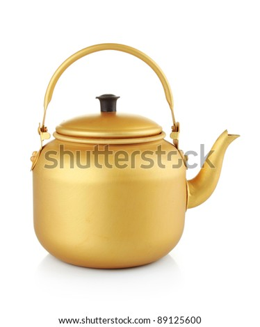 A gold tea kettle on a white background