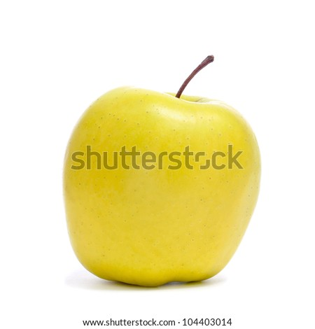 a golden apple on a white background - stock photo