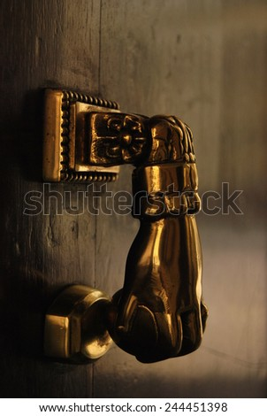 A golden door-knocker