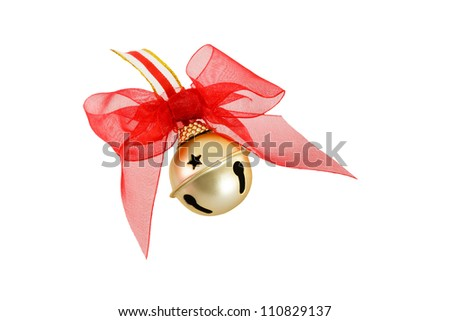 A golden jingle bell is a traditional Christmas symbol shown here with a decorative red bow isolated on a white background