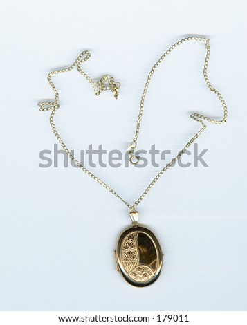 A golden locket and chain