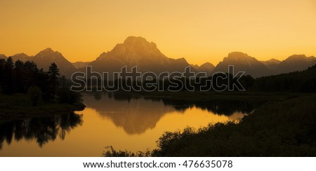 A golden sunset over Oxbow Bend in Grand Teton National Park, Wyoming.