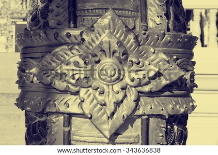 a Golden thai art stucco wall in Thai temple in vintage color style - stock photo