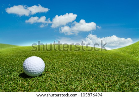 a golf ball on green field - stock photo