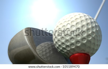A golf ball perched on its tee with a wood in ready to be teed off position