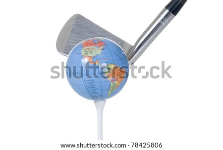 A golf club in mid-swing is about to hit a golf ball that resembles a globe. - stock photo