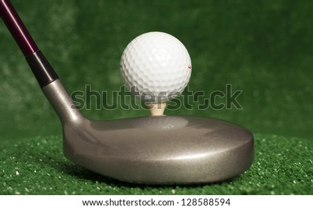 A golf club prepares to drive the ball sitting on tee - stock photo