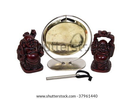 A gong hanging from a frame makes a resonating sound when struck with a beater with two Buddha figurines - path included