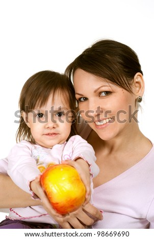 A good Caucasian mother with a beautiful daughter on a light background