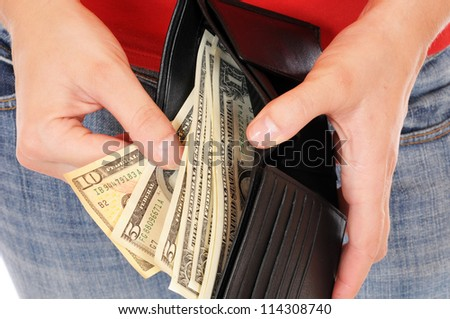 A good filled wallet in the hands - stock photo