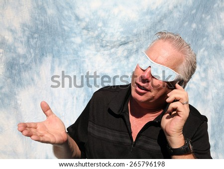 A good looking man talking on his cell phone. Cell Phones are very important for communication and business around the world. - stock photo