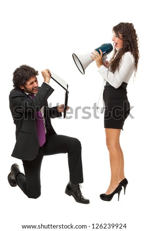 A gorgeous businesswoman yelling at a businessman with a megaphone - stock photo