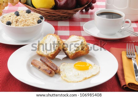 A gourmet breakfast with sausage, eggs, coffee cake muffins and rice