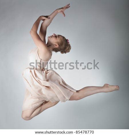A graceful girl in jump - stock photo
