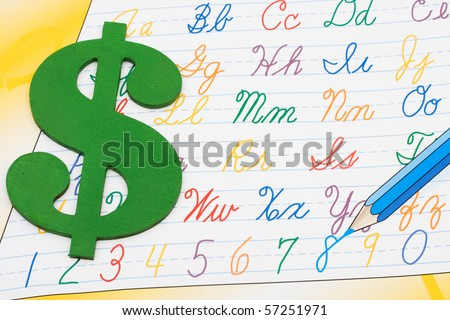 A grade school workbook for writing, Cost of education - stock photo