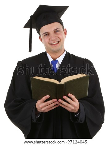 A graduate with a book, isolated on white - stock photo