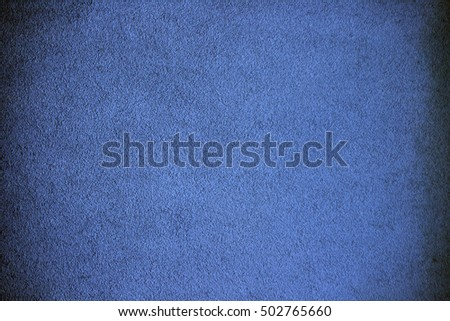 A grainy grungy background in blue.