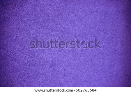 A grainy grungy background in purple.