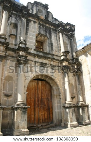 A Grand facade of a colonial Spanish church in the old Guatemalan capitol city of Antigua. - stock photo