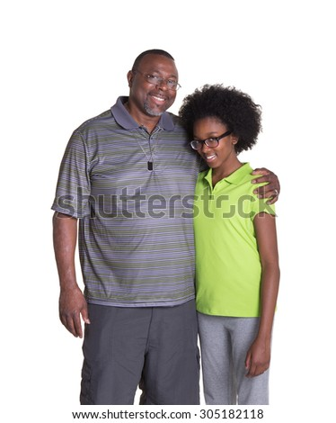 A grandfather and his granddaughter standing together - stock photo