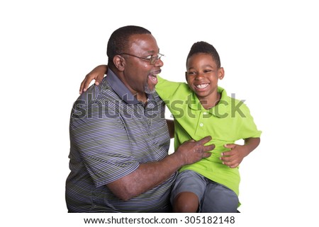 A grandfather and his grandson having fun