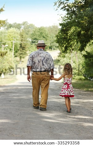 a grandfather with the grandson go on the road family - stock photo