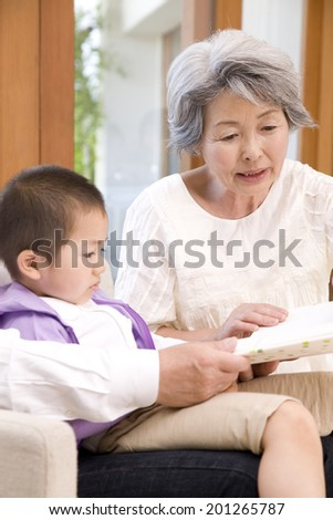A grandma reading a book to her grandson