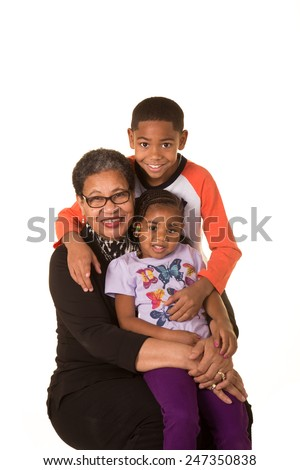A grandmother and her grandchildren isolated on white - stock photo