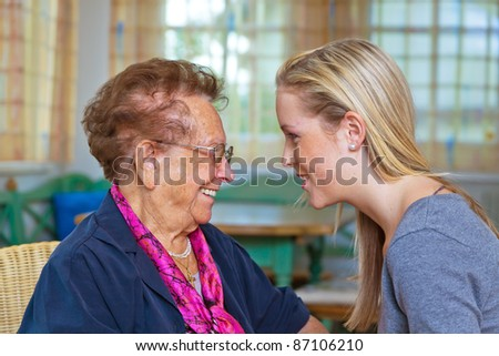 a grandson to visit his grandmother. listen to the conversation. - stock photo