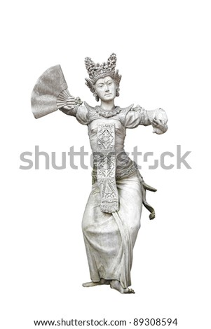 A granite statue of an exotic Balinese cultural legong maiden dancer in traditional costume, isolated against white.