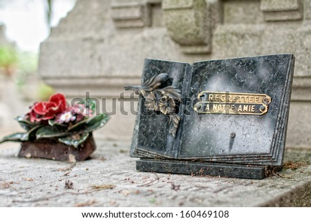 A gravestone and an epitaph in French, Pere Lachaise cemetery, Paris, France - stock photo