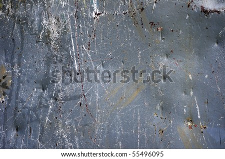 A gray metal surface that has been dented and scratched - stock photo