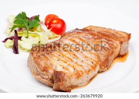 A great beef steak with vegetables. Close up. - stock photo