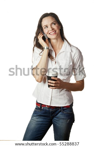 A great portrait of an attractive casual young woman talking on her mobile and holding a take away coffee - stock photo