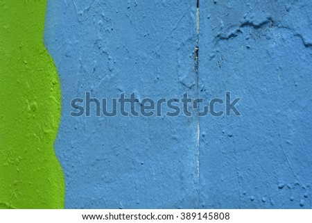a green and blue painted wall closeup