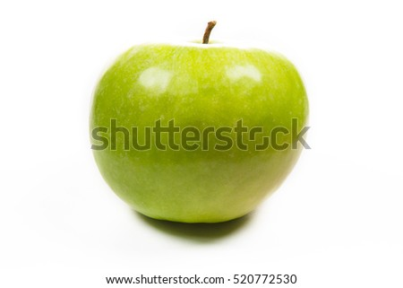A green apple on white background.
