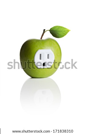 A green apple with an electrical outlet  - stock photo