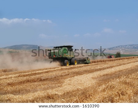 A Green combine working in the fields