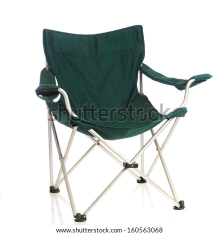 A green folding lawn chair on a white background - stock photo