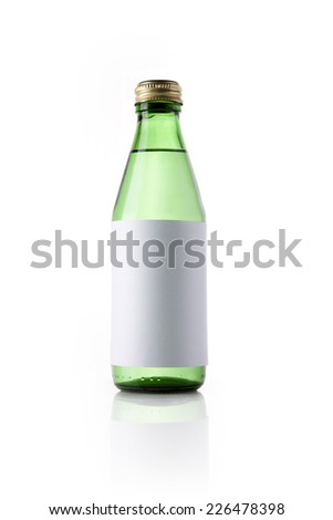 A green glass bottle with blank label and drink reflective bottom isolated white. - stock photo