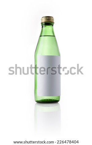 A green glass bottle with blank label and drink reflective bottom isolated white.