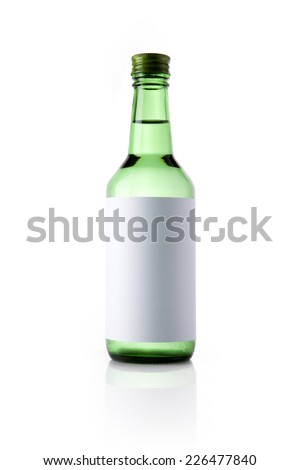 A green glass bottle with liquor with blank label reflective bottom isolated white. - stock photo
