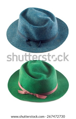 A green hat and a blue hat isolated on a vertical white background with plenty of space for text