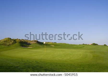 a green in a golf course - stock photo