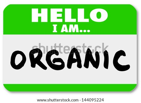 A green nametag sticker with the words Hello I Am Organic to illustrate natural food sources and options free of pesticides and growth hormones - stock photo