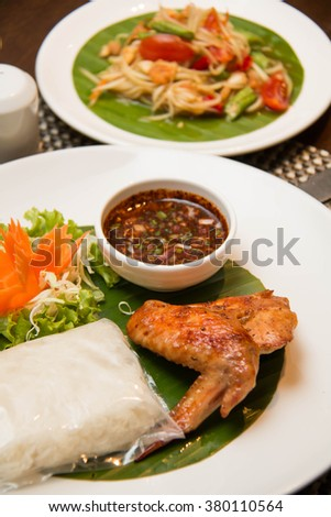 A Green papaya salad, grilled chicken and sticky rice