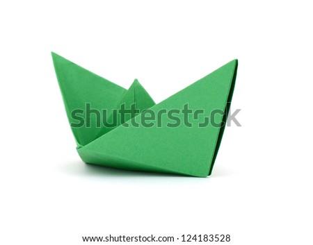 A green paper ship - stock photo