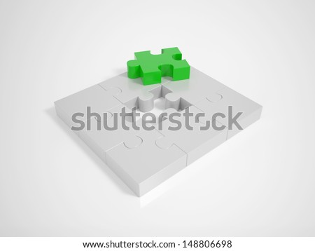 A green Piece completing a Puzzle on a bright Background