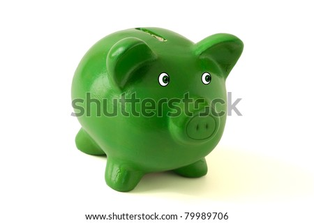 A green piggy bank on a white background, savings - stock photo