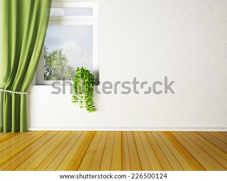 a green plant on the windowsill - stock photo